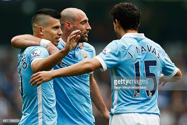 Sergio Aguero of Manchester City celebrates scoring his fourth goal with Jesus Navas and Pablo Zabaleta during the Barclays Premier League match...