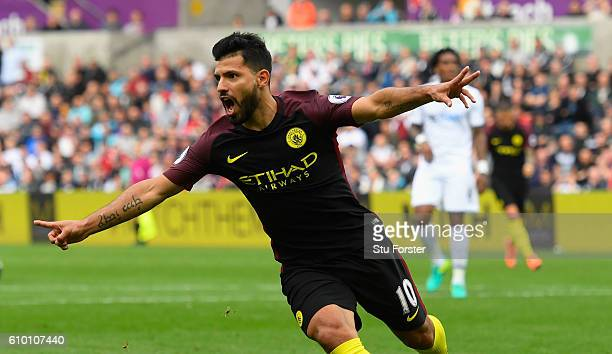 Sergio Aguero of Manchester City celebrates scoring his sides first goal during the Premier League match between Swansea City and Manchester City at...
