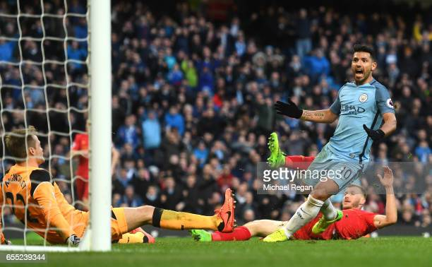 Sergio Aguero of Manchester City celebrates scoring his sides first goal during the Premier League match between Manchester City and Liverpool at...