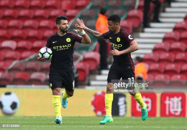 Sergio Aguero of Manchester City celebrates scoring his sides first goal from the penalty spot with Gabriel Jesus of Manchester City during the...