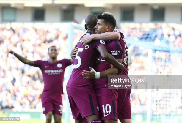 Sergio Aguero of Manchester City celebrates scoring his sides first goal with Kevin De Bruyne of Manchester City and Fernandinho of Manchester City...