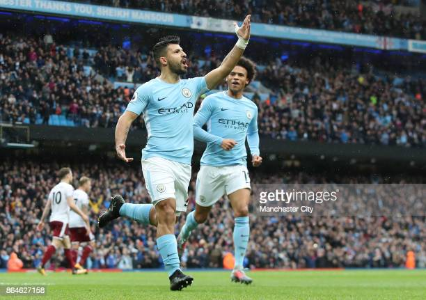 Sergio Aguero of Manchester City celebrates scoring his side's first goal with Leroy Sane during the Premier League match between Manchester City and...
