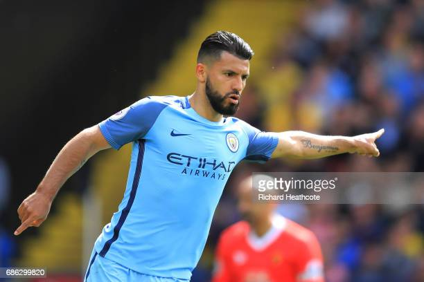 Sergio Aguero of Manchester City celebrates scoring his sides second goal during the Premier League match between Watford and Manchester City at...