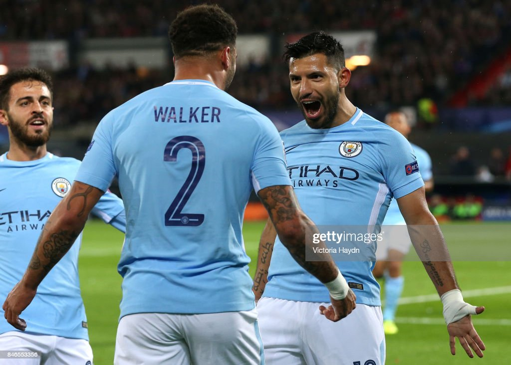 Sergio Aguero of Manchester City celebrates scoring his sides second goal with Kyle Walker of Manchester City and David Silva of Manchester City during the UEFA Champions League group F match between Feyenoord and Manchester City at Feijenoord Stadion on September 13, 2017 in Rotterdam, Netherlands.