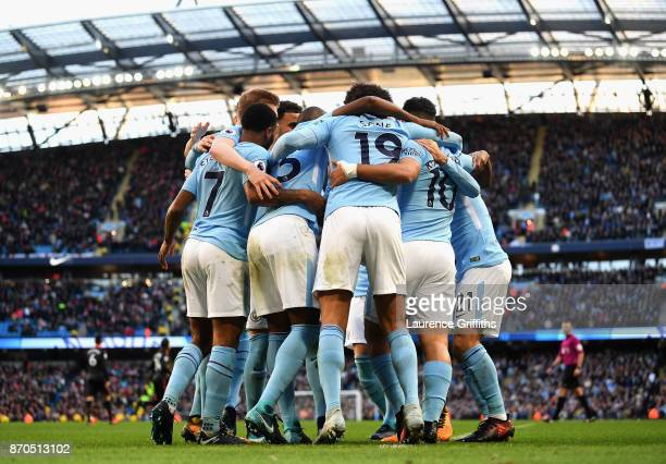 Sergio Aguero of Manchester City celebrates scoring his sides second goal with his Manchester City team mates during the Premier League match between...