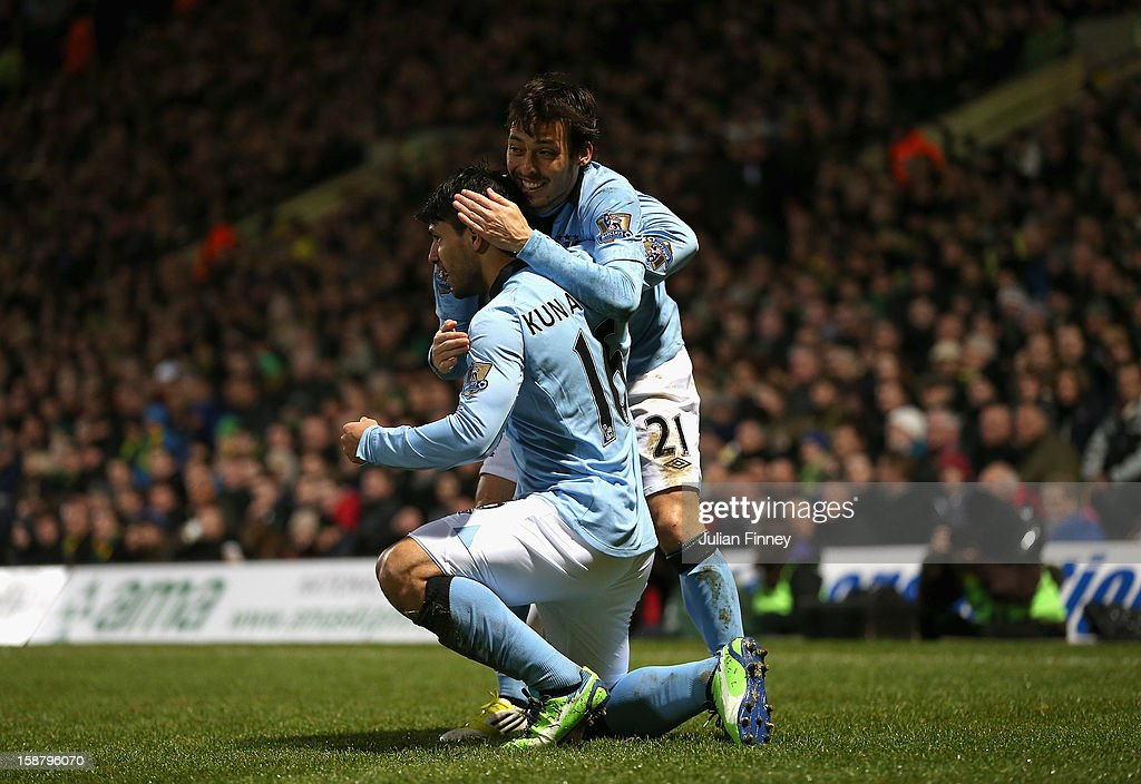 Sergio Aguero of Manchester City celebrates scoring his side's third goal with team mate David Silva (R) during the Barclays Premier League match between Norwich City and Manchester City at Carrow Road on December 29, 2012 in Norwich, England.