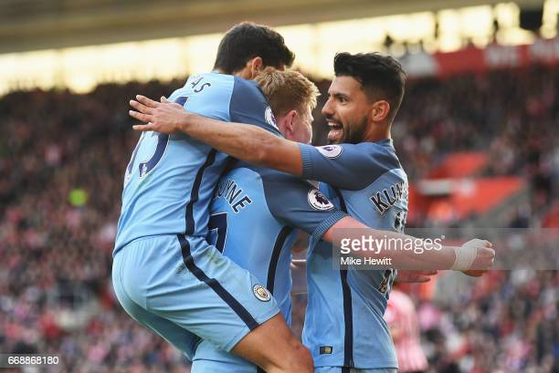 Sergio Aguero of Manchester City celebrates scoring his sides third goal with Kevin De Bruyne of Manchester City and Jesus Navas of Manchester City...