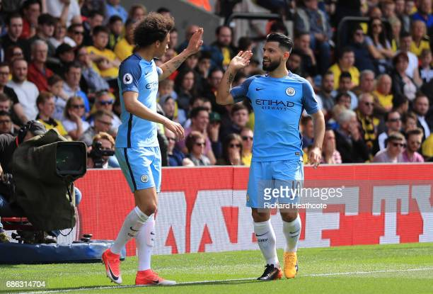 Sergio Aguero of Manchester City celebrates scoring his sides third goal with Leroy Sane of Manchester City during the Premier League match between...