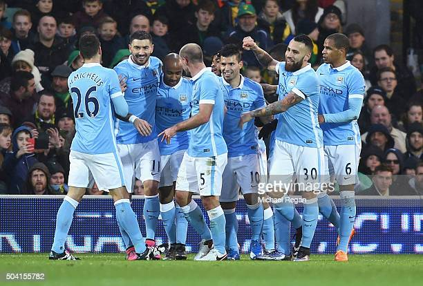 Sergio Aguero of Manchester City celebrates scoring his team's first goal with his team mates during the Emirates FA Cup third round match between...