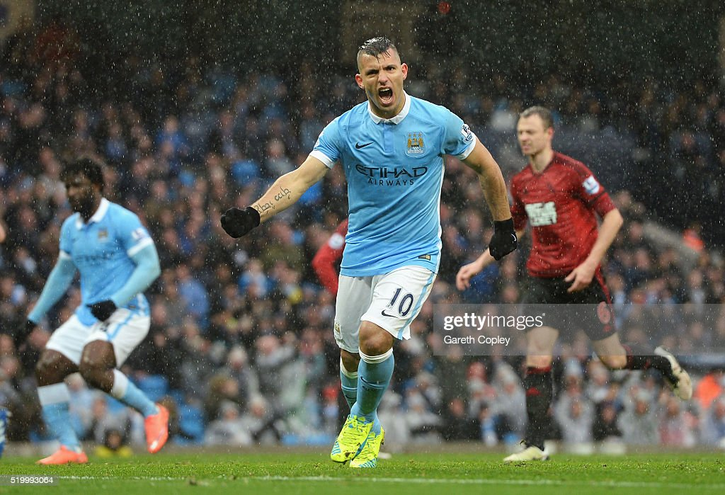 Sergio Aguero of Manchester City celebrates scoring his team's first goal during the Barclays Premier League match between Manchester City and West...