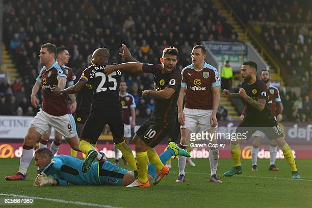 Sergio Aguero of Manchester City celebrates scoring his team's first goal during the Premier League match between Burnley and Manchester City at Turf...