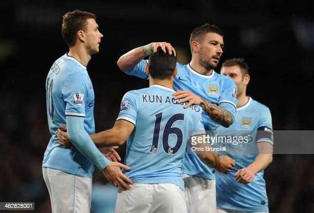 Sergio Aguero of Manchester City celebrates scoring his team's fourth goal with teammates Edin Dzeko and Aleksandar Kolarov during the Budweiser FA...