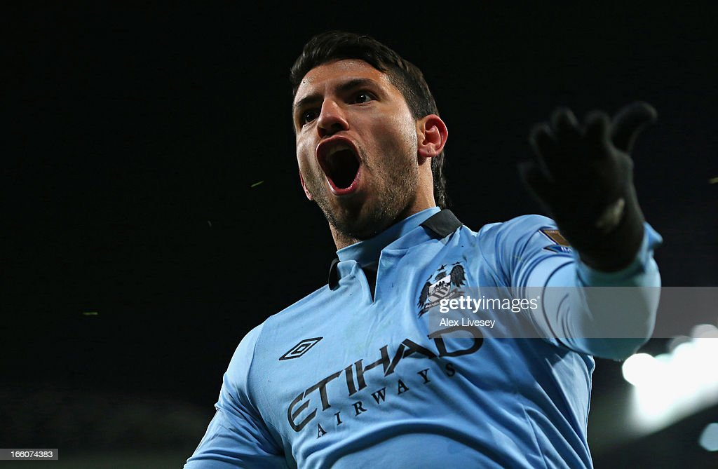 Sergio Aguero of Manchester City celebrates scoring his team's second goal to make the score 1-2 during the Barclays Premier League match between Manchester United and Manchester City at Old Trafford on April 8, 2013 in Manchester, England.