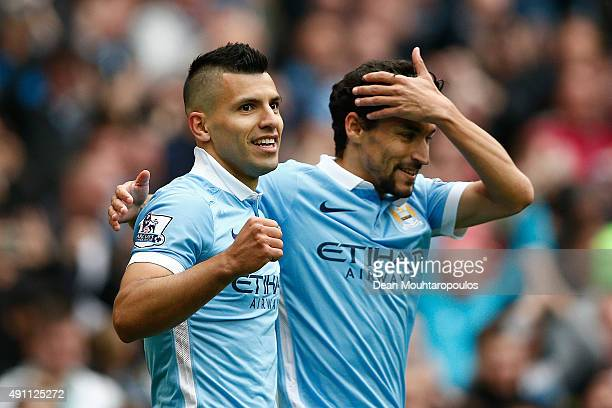 Sergio Aguero of Manchester City celebrates scoring his team's third and hat trick goal with his team mate Jesus Navas during the Barclays Premier...