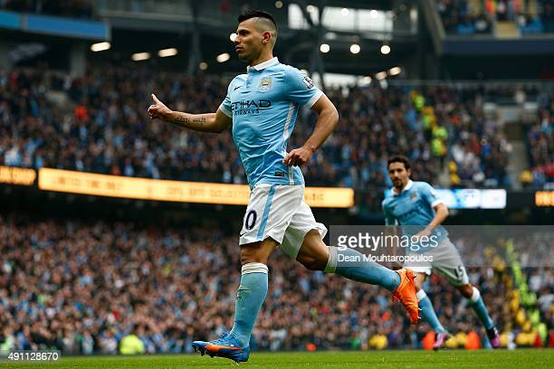 Sergio Aguero of Manchester City celebrates scoring his team's third and hat trick goal during the Barclays Premier League match between Manchester...