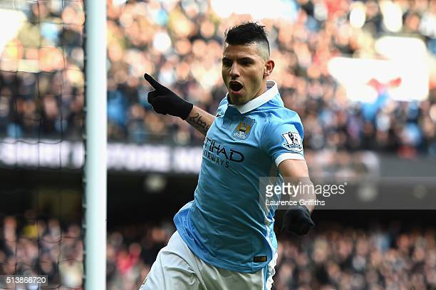 Sergio Aguero of Manchester City celebrates scoring his team's third goal during the Barclays Premier League match between Manchester City and Aston...