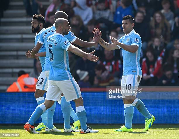 Sergio Aguero of Manchester City celebrates scoring his team's third goal with his team mates during the Barclays Premier League match between AFC...