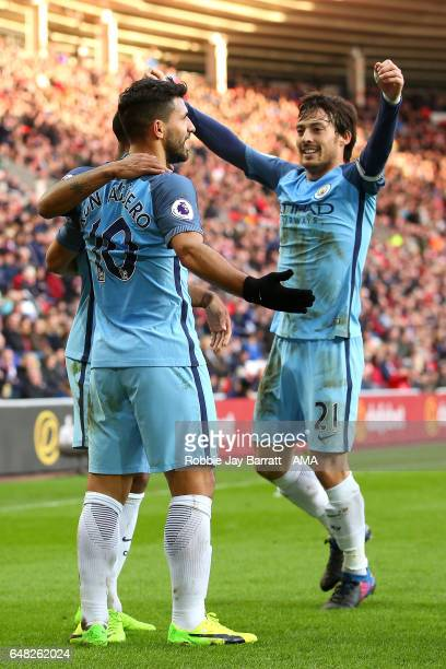 Sergio Aguero of Manchester City celebrates scoring the first goal to make the score 01 with David SIlva during the Premier League match between...