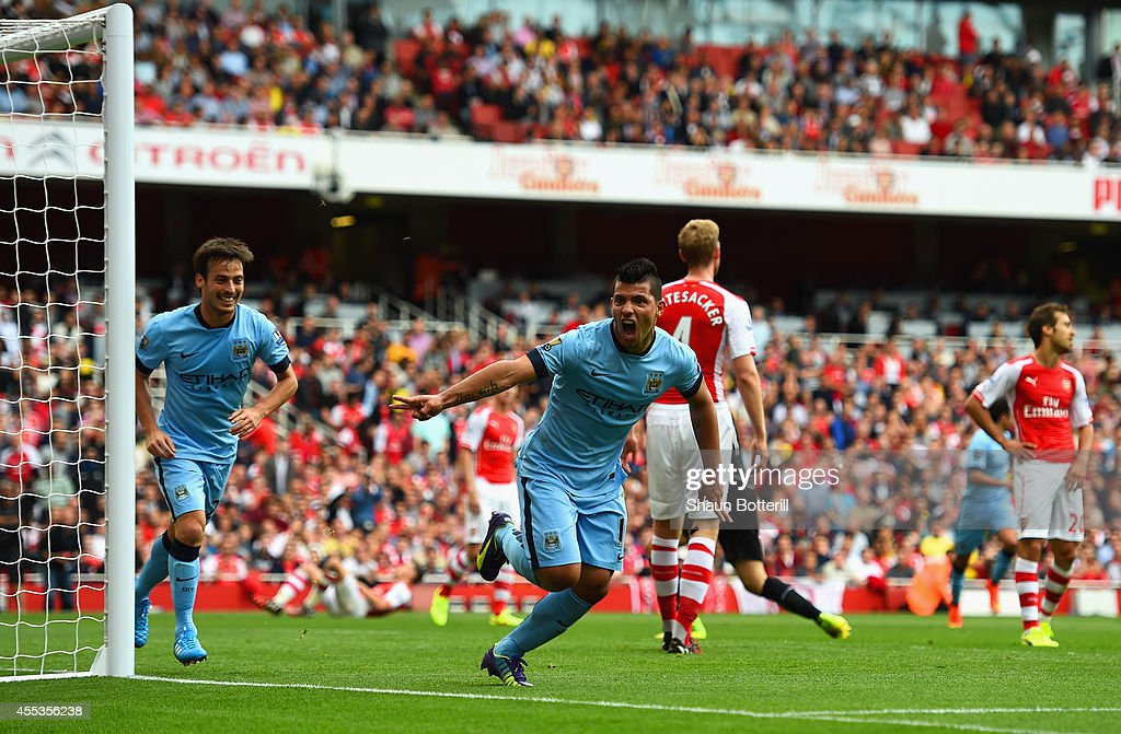 Sergio Aguero of Manchester City celebrates scoring the opening goal during the Barclays Premier League match between Arsenal and Manchester City at...