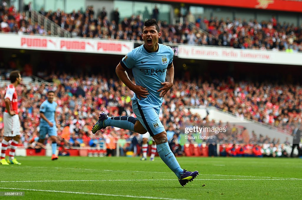 Sergio Aguero of Manchester City celebrates scoring the opening goal during the Barclays Premier League match between Arsenal and Manchester City at Emirates Stadium on September 13, 2014 in London, England.