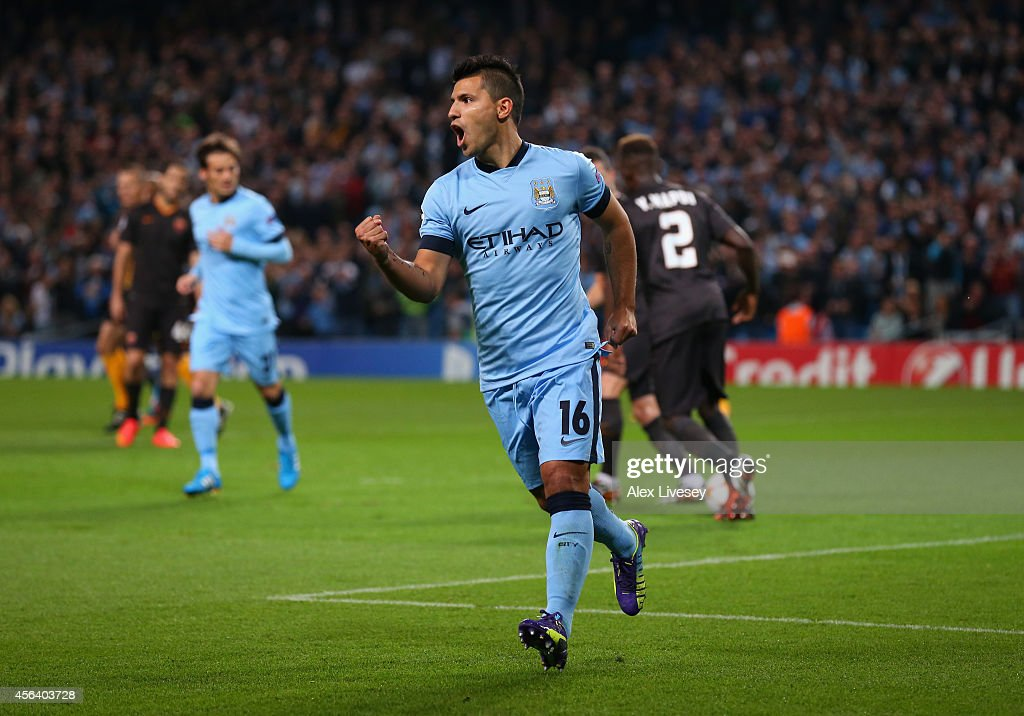 Sergio Aguero of Manchester City celebrates scoring the opening goal from a penalty kick during the UEFA Champions League Group E match between...