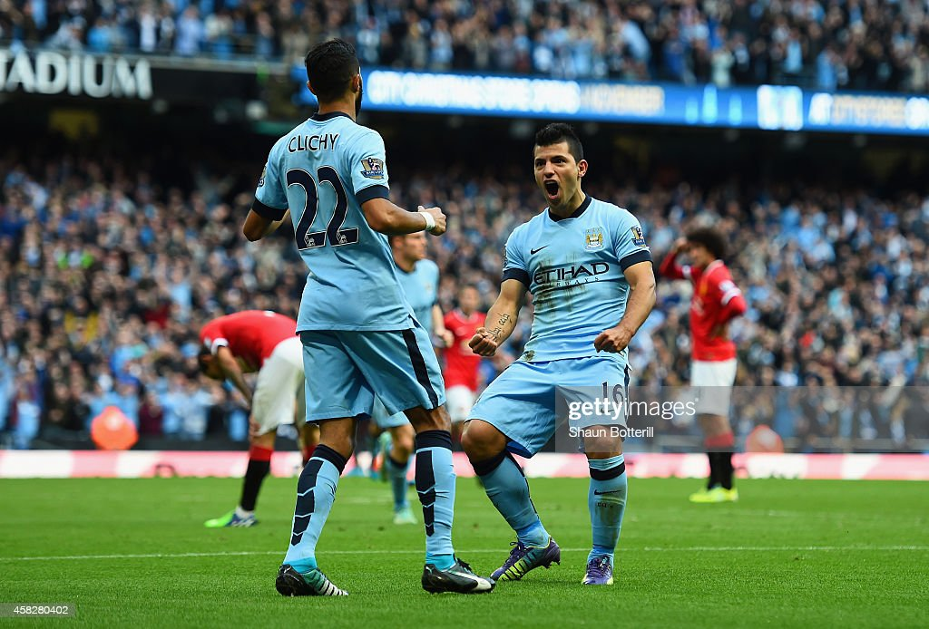 Sergio Aguero of Manchester City celebrates scoring the opening goal with Gael Clichy of Manchester City during the Barclays Premier League match between Manchester City and Manchester United at Etihad Stadium on November 2, 2014 in Manchester, England.