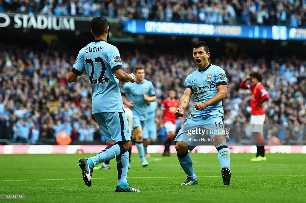 Sergio Aguero of Manchester City celebrates scoring the opening goal with Gael Clichy of Manchester City during the Barclays Premier League match...
