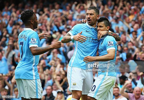 Sergio Aguero of Manchester City celebrates scoring the opening goal with Aleksandar Kolarov and Raheem Sterling of Manchester City during the...