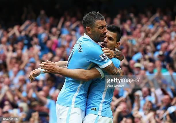 Sergio Aguero of Manchester City celebrates scoring the opening goal with Aleksandar Kolarov of Manchester City during the Barclays Premier League...