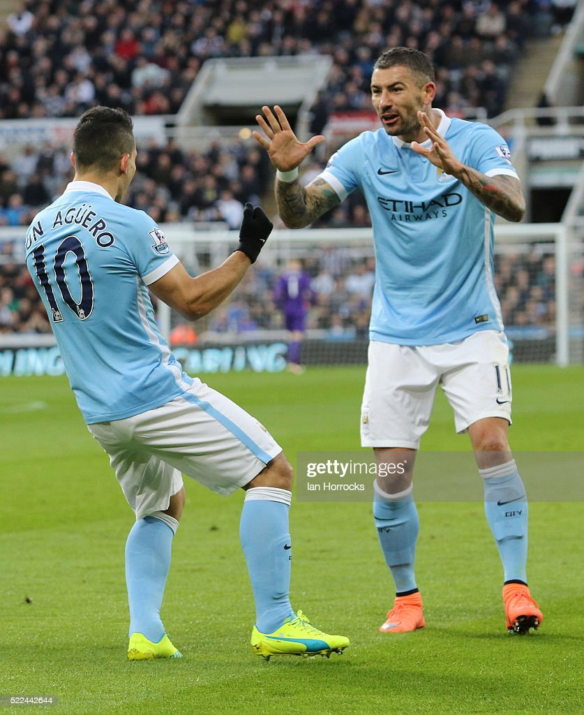 Sergio Aguero of Manchester City (#10) celebrates scoring the opening goal with Aleksandar Kolarov (R) during the Barclays Premier League match between Newcastle United and Manchester City at St James' Park on April 19, 2016 in Newcastle upon Tyne, England.