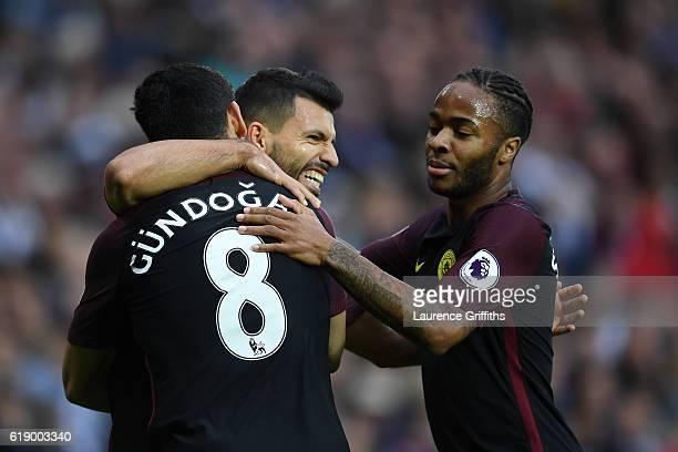 Sergio Aguero of Manchester City celebrates scoring the opening goal with his team mates Ilkay Gundogan and Raheem Sterling during the Premier League...
