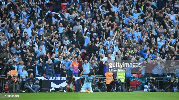 Sergio Aguero of Manchester City celebrates scoring the opening goal in front of supporters during the Emirates FA Cup SemiFinal match between...