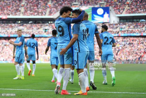 Sergio Aguero of Manchester City celebrates scoring the opening goal with Leroy Sane during the Emirates FA Cup SemiFinal match between Arsenal and...