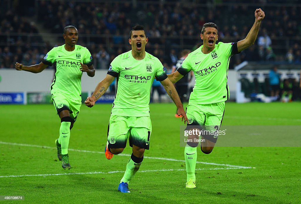 Sergio Aguero of Manchester City (C) celebrates scoring their second goal from the penalty spot during the UEFA Champions League Group D match between VfL Borussia Monchengladbach and Manchester City at the Borussia Park Stadium on September 30, 2015 in Moenchengladbach, Germany.