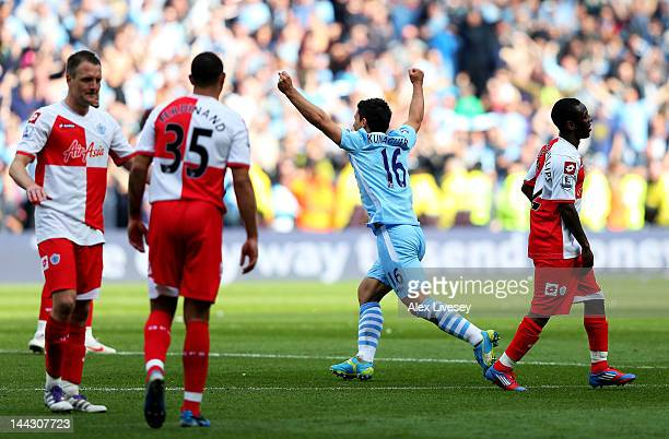 Sergio Aguero of Manchester City celebrates winning the title as the final whistle blows during the Barclays Premier League match between Manchester...