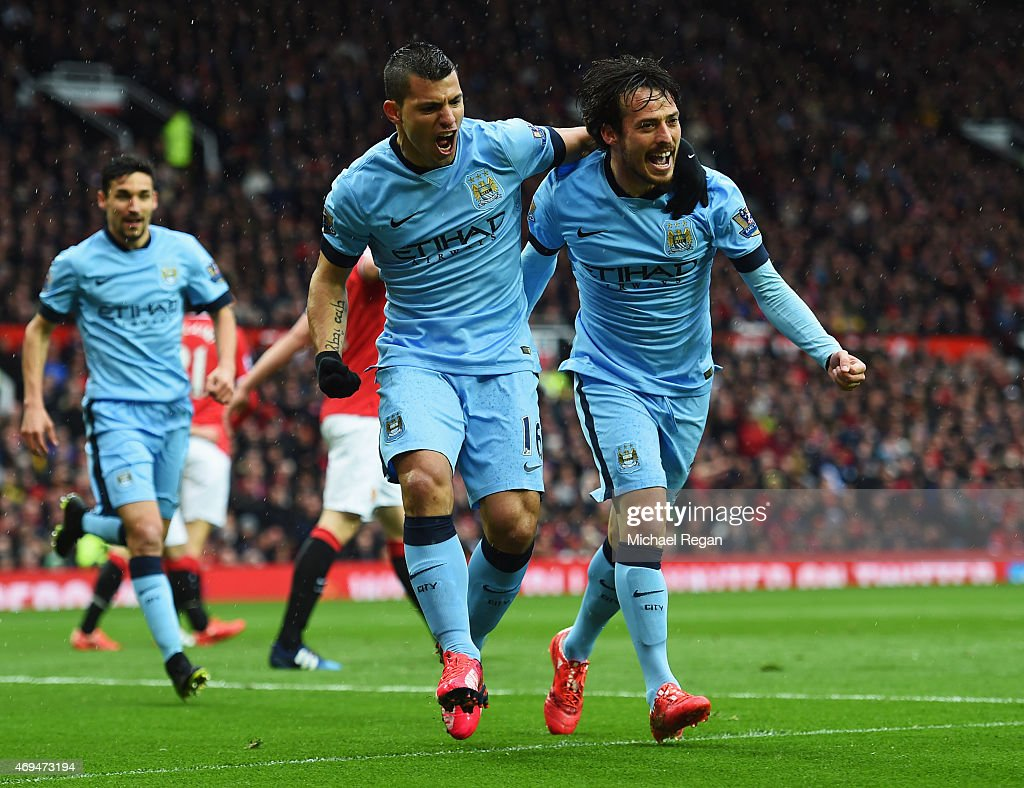 Sergio Aguero of Manchester City celebrates with David Silva and team mates as he scores their first goal during the Barclays Premier League match...