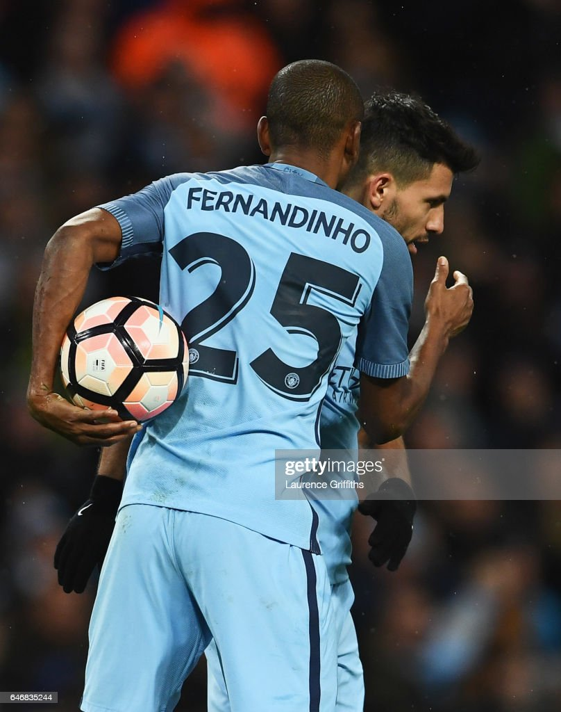 Sergio Aguero of Manchester City (R) celebrates with Fernandinho as he scores their fourth goal during The Emirates FA Cup Fifth Round Replay match between Manchester City and Huddersfield Town at Etihad Stadium on March 1, 2017 in Manchester, England.