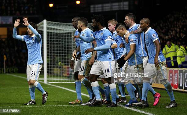 Sergio Aguero of Manchester City celebrates with his team mates after scoring his side's second goal during the Barclays Premier League match between...