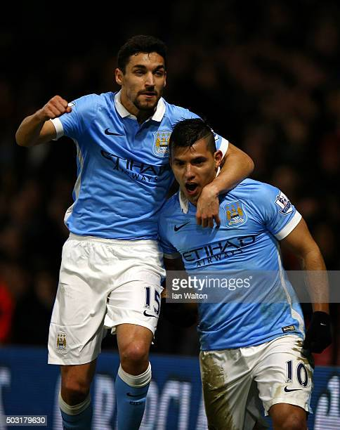 Sergio Aguero of Manchester City celebrates with Jesus Navas of Manchester City after scoring his side's second goal during the Barclays Premier...