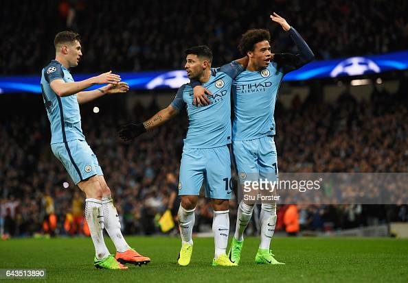 Sergio Aguero of Manchester City celebrates with John Stones and Leroy Sane of Manchester City as he scores their third goal during the UEFA...