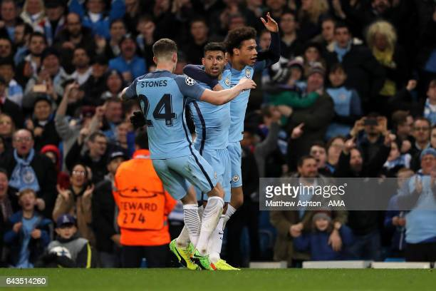 Sergio Aguero of Manchester City celebrates with John Stones and Leroy Sane after scoring his team's third goal to make the score 33 during the UEFA...