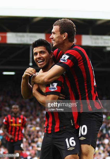 Sergio Aguero of Manchester City celebrates with team mate Edin Dzeko after scoring his sides second goal during the Barclays Premier League match...