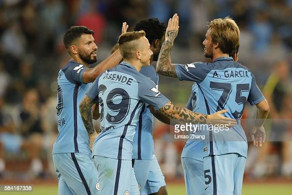 Sergio Aguero of Manchester City celebrates with team mates after he scores the first goal during the 2016 International Champions Cup match between...