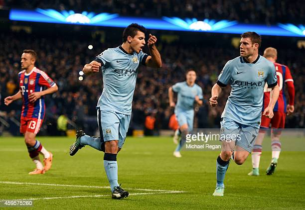 Sergio Aguero of Manchester City celebrates with teammate James Milner after scoring the opening goal from the penalty spot during the UEFA Champions...