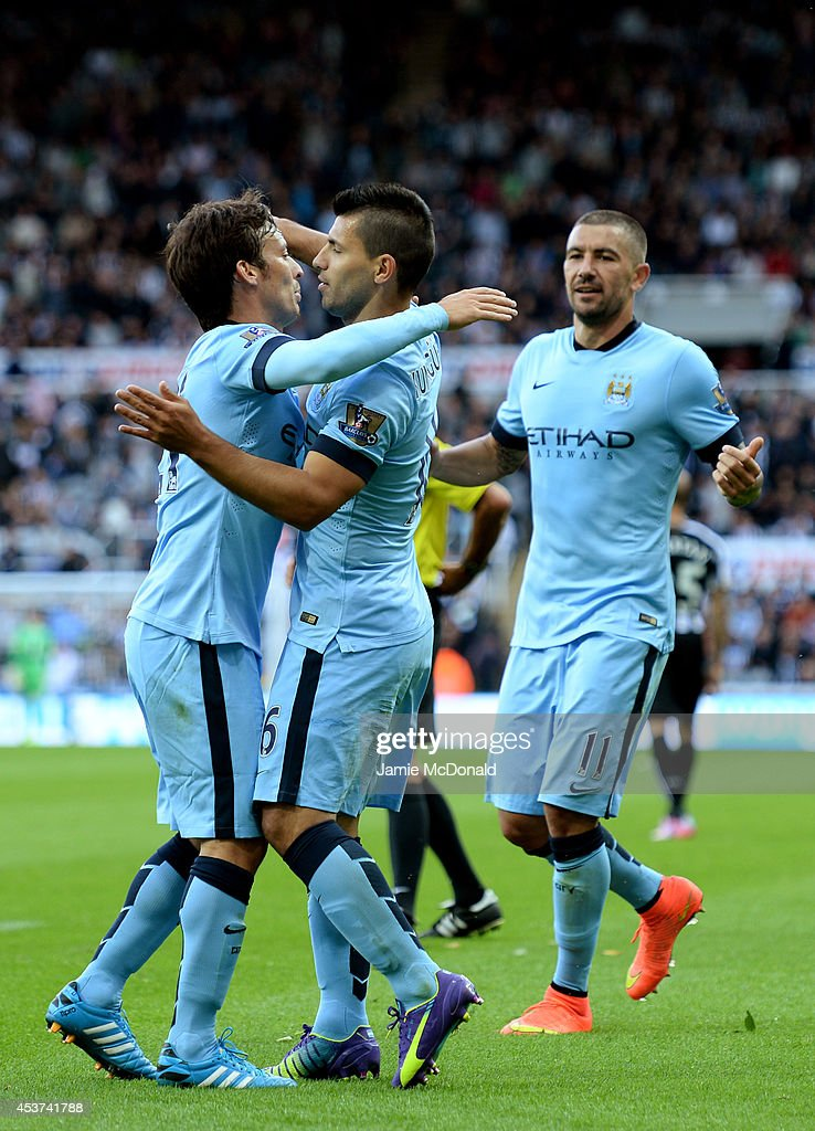 <a gi-track='captionPersonalityLinkClicked' href=/galleries/search?phrase=Sergio+Aguero&family=editorial&specificpeople=1100704 ng-click='$event.stopPropagation()'>Sergio Aguero</a> of Manchester City celebrates with teammates <a gi-track='captionPersonalityLinkClicked' href=/galleries/search?phrase=David+Silva&family=editorial&specificpeople=675795 ng-click='$event.stopPropagation()'>David Silva</a> (L) and Aleksandr Kolarov (R) celebrates after scoring his team's second goal during the Barclays Premier League match between Newcastle United and Manchester City at St James' Park on August 17, 2014 in Newcastle upon Tyne, England.