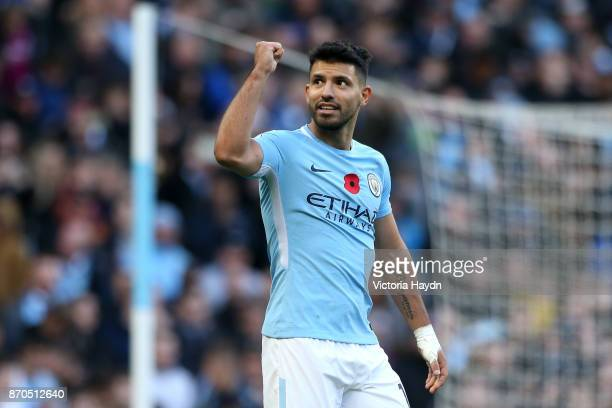Sergio Aguero of Manchester City celebrtes scoring his sides second goal during the Premier League match between Manchester City and Arsenal at...