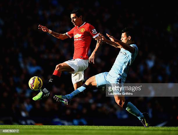 Sergio Aguero of Manchester City challenges Angel di Maria of Manchester United during the Barclays Premier League match between Manchester City and...