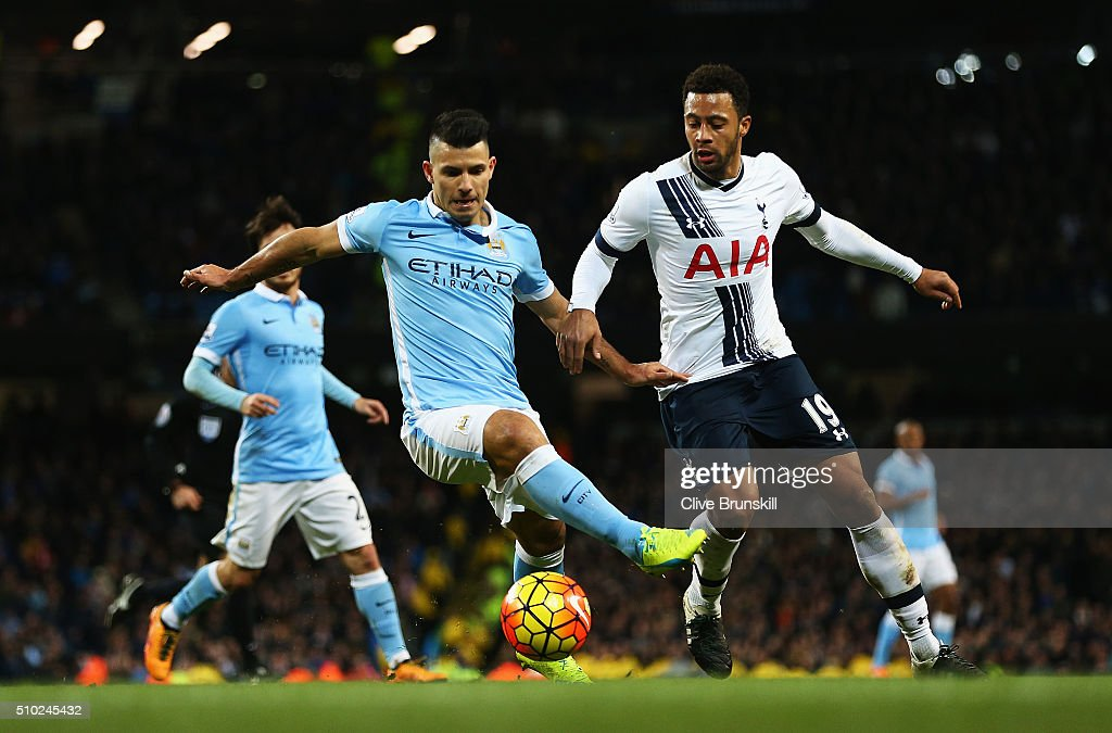 <a gi-track='captionPersonalityLinkClicked' href=/galleries/search?phrase=Sergio+Aguero&family=editorial&specificpeople=1100704 ng-click='$event.stopPropagation()'>Sergio Aguero</a> of Manchester City challenges for the ball with Mousa Dembele of Tottenham Hotspur during the Barclays Premier League match between Manchester City and Tottenham Hotspur at Etihad Stadium on February 14, 2016 in Manchester, England.