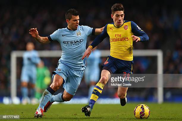 Sergio Aguero of Manchester City challenges Hector Bellerin of Arsenal during the Barclays Premier League match between Manchester City and Arsenal...