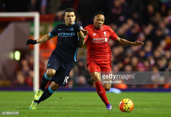 Sergio Aguero of Manchester City challenges Nathaniel Clyne of Liverpool for the ball during the Barclays Premier League match between Liverpool and...